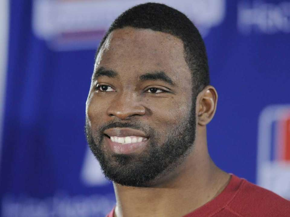 Giants defensive end Justin Tuck speaks to reporters.