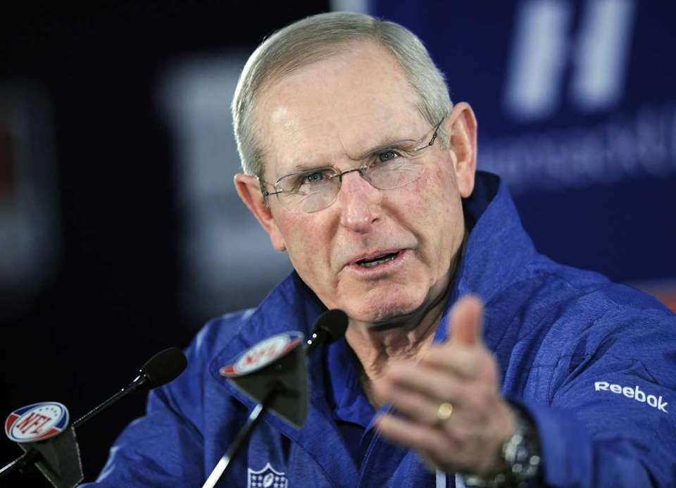 Giants coach Tom Coughlin speaks to the media
