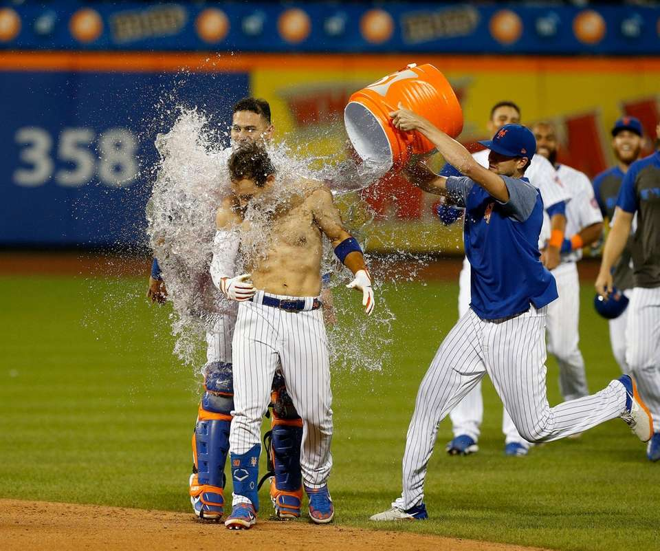 Michael Conforto #30 of the Mets celebrates his