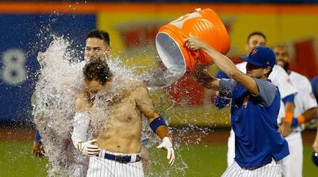 Michael Conforto #30 of the Mets celebrates his