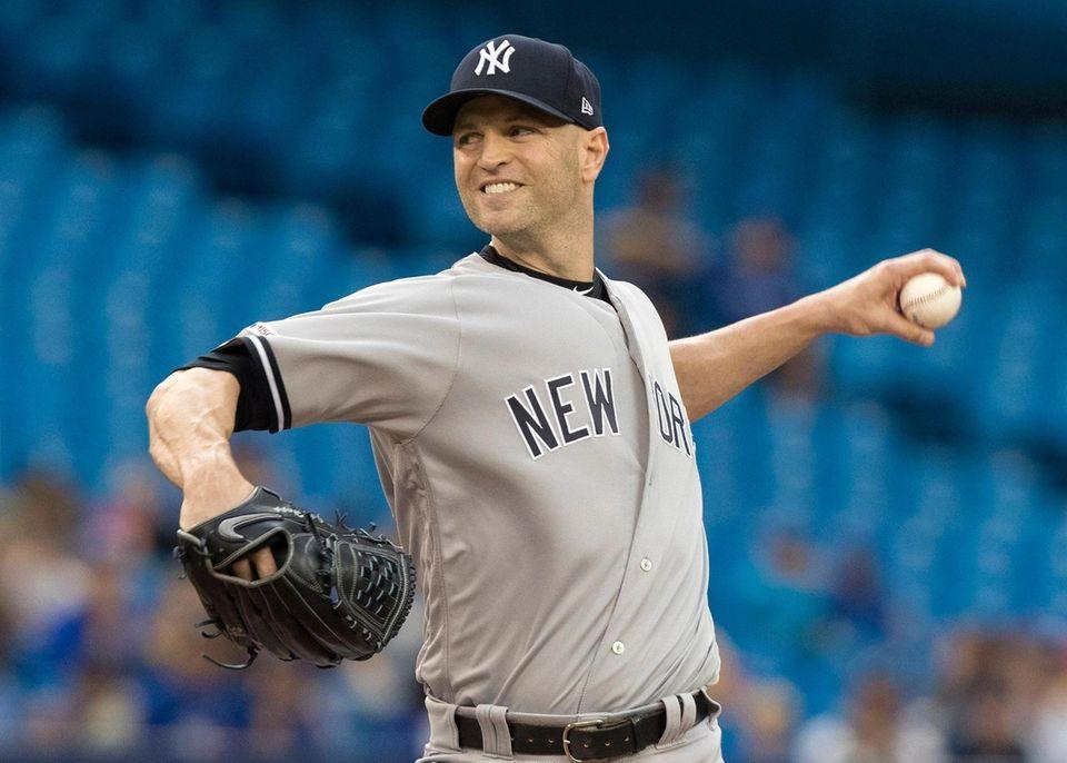 New York Yankees starting pitcher J.A. Happ throws