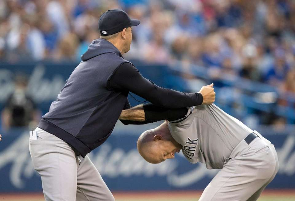 New York Yankees manager Aaron Boone holds Brett