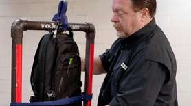 Steve Naremore, founder and CEO of TuffyPacks, hangs