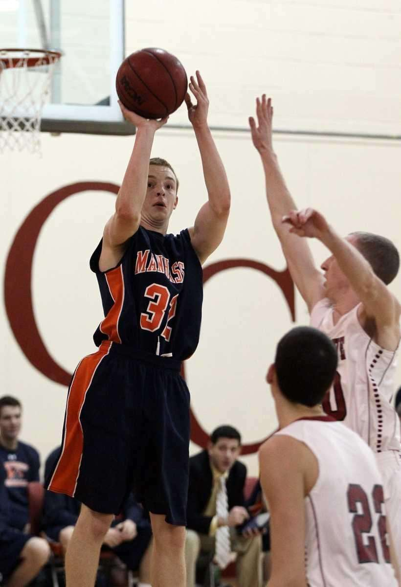 Danny Merola #32 of Manhasset shoots over two
