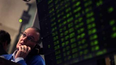A trader takes an order in the Standard