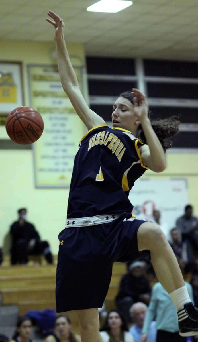 Massapequa's Morgan Roessler gets fouled while driving to