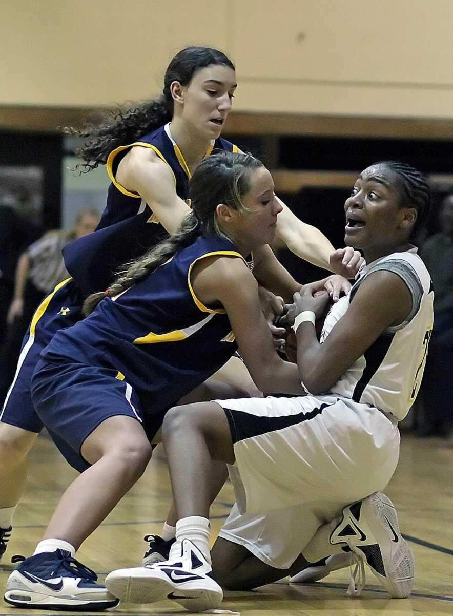 Massapequa's Danielle Doherty tries to wrestle ball away
