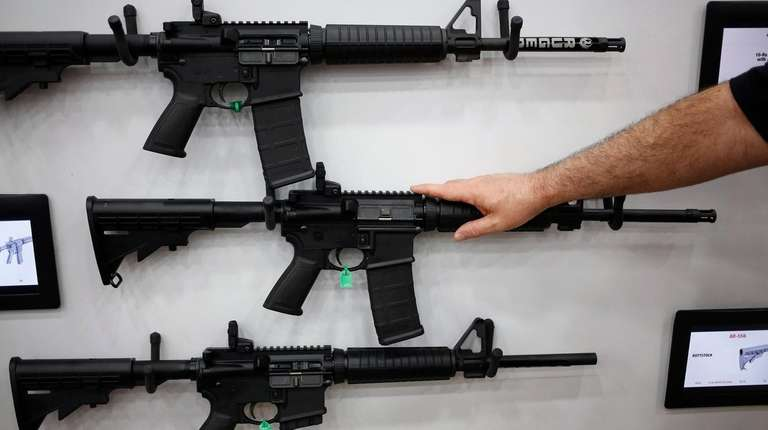 AR-15 rifles are displayed on the exhibit floor