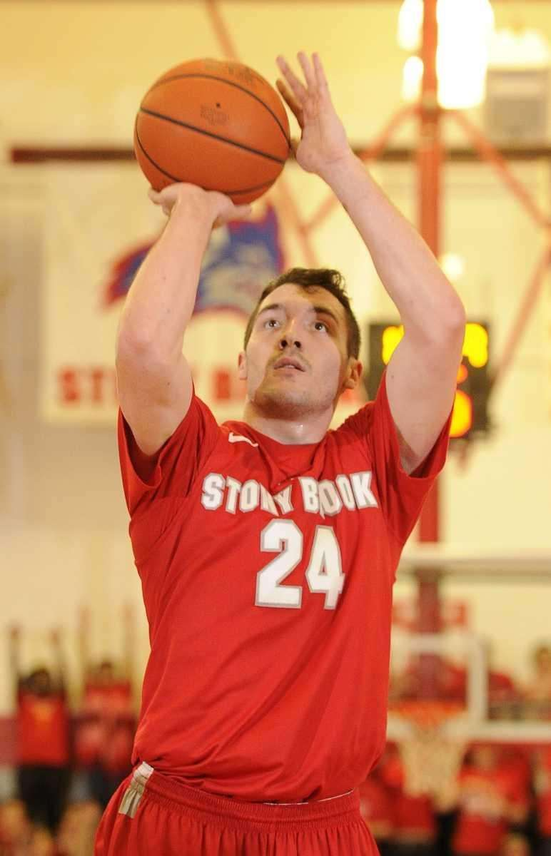 Stony Brook guard Tommy Brenton shoots a foul