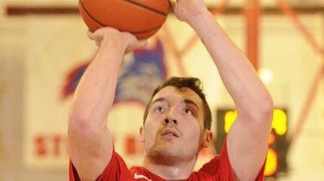 Stony Brook guard Tommy Brenton shoots a foul
