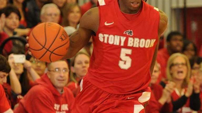 Stony Brook guard Dave Coley drives the ball