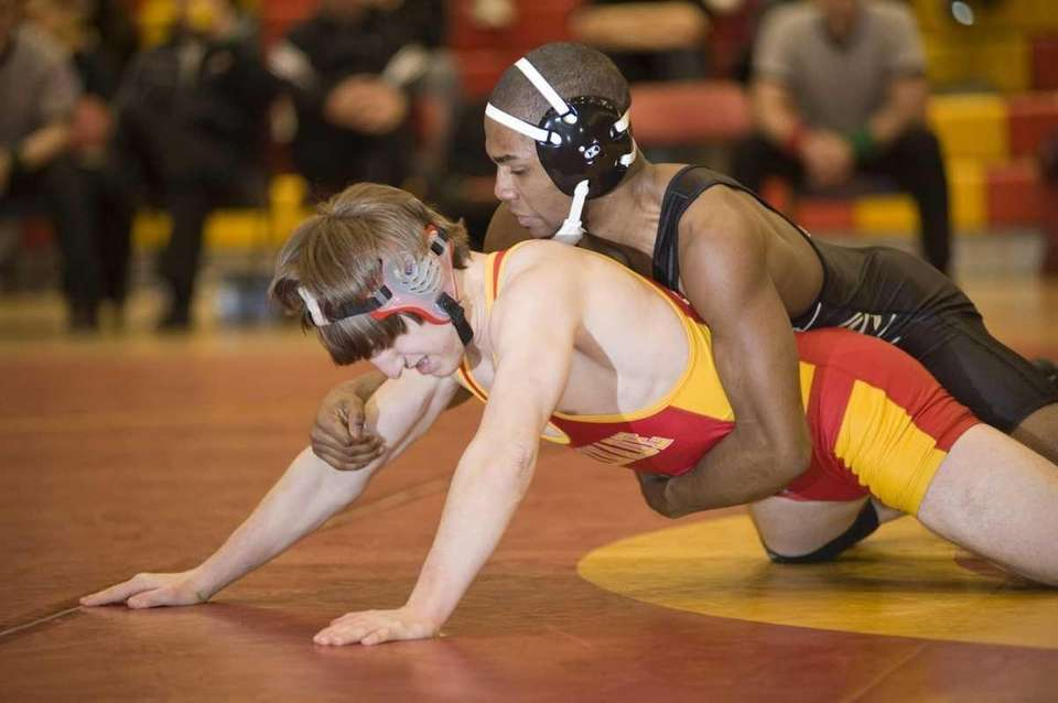 St. Anthony's Jamel Hudson (top) wins his match