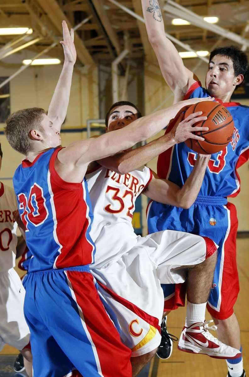 Chaminade's John Gallego (32) is fouled by St.