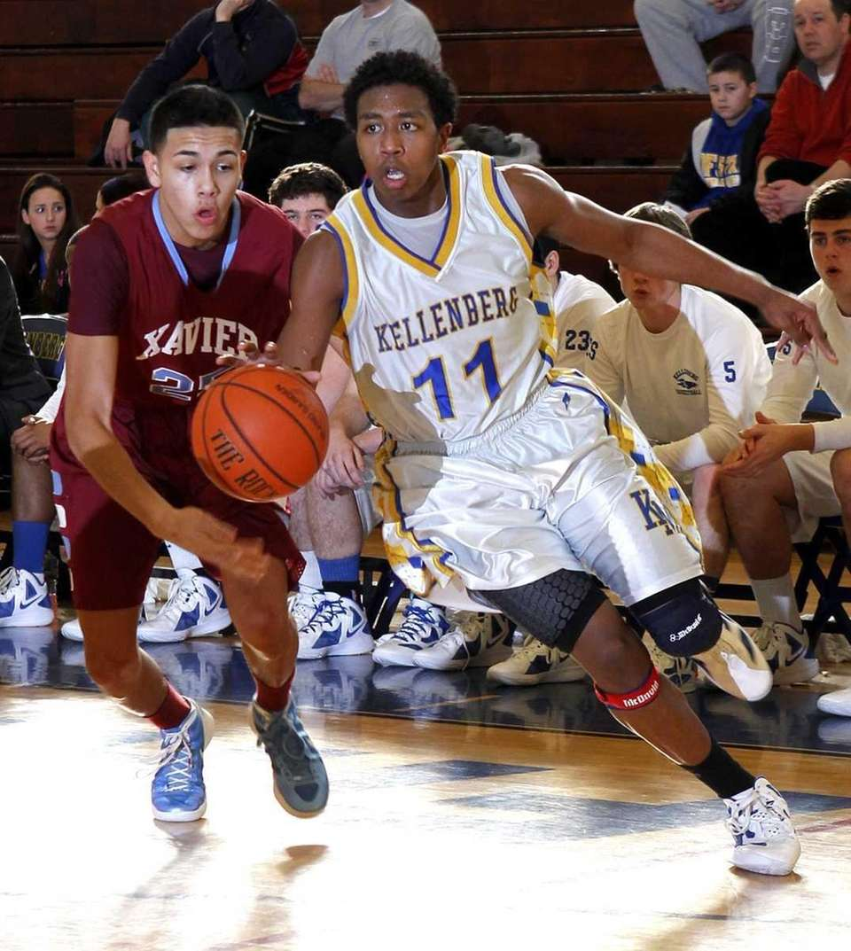 Kellenberg's Jeremy Arthur (11) drives the baseline ahead