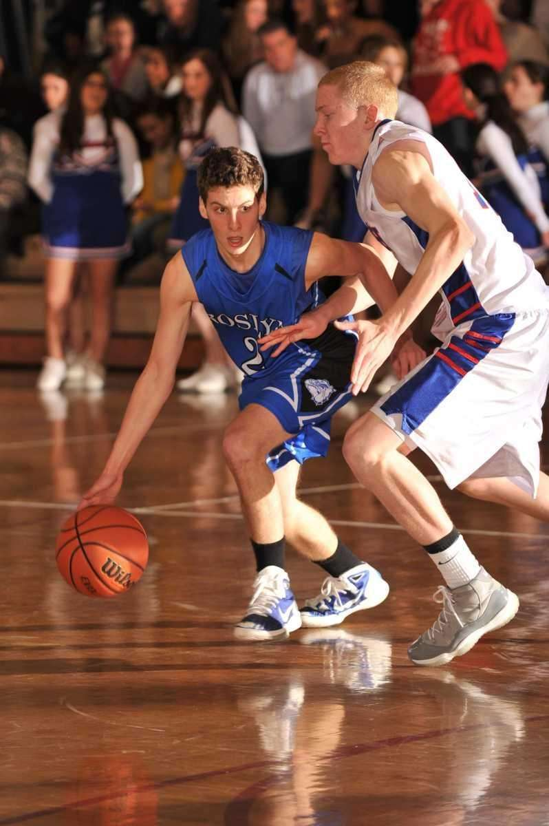 Roslyn's Benjamin Rothman drives around South Side's Kevin
