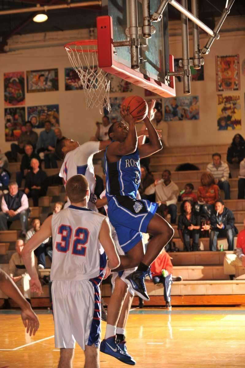 Roslyn's Malik Forte drives for a layup during