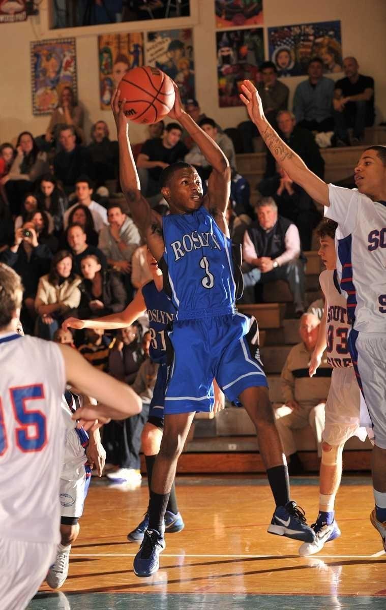 Roslyn's Terrence Pierce pulls down a rebound. (Jan.