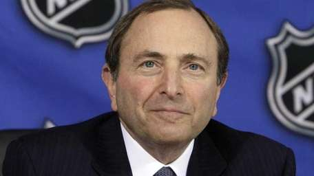 NHL Commissioner Gary Bettman poses at the offices