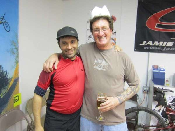 Carl Belcastro, left, owner of Adventure Cycles &