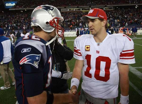 Tom Brady congratulates Eli Manning after a game.