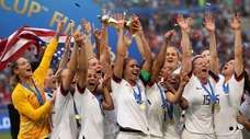 United States' Alex Morgan holds the trophy celebrating