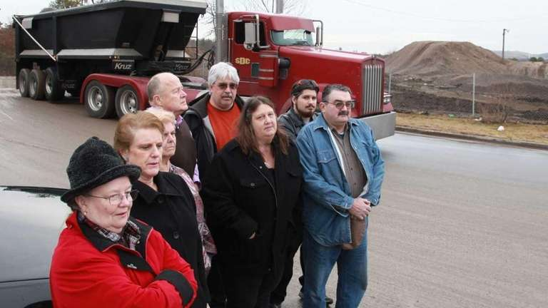 Members of local civic organizations stand at the