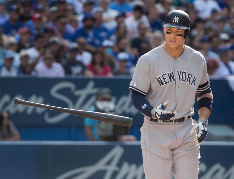 New York Yankees' Aaron Judge tosses his bat
