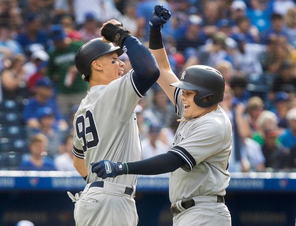 New York Yankees' Gio Urshela, right, celebrates with