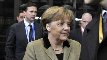 German Federal Chancellor Angela Merkel arrives for a