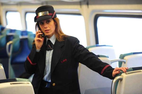 LIRR Conductor June Dicarlo using her cell phone