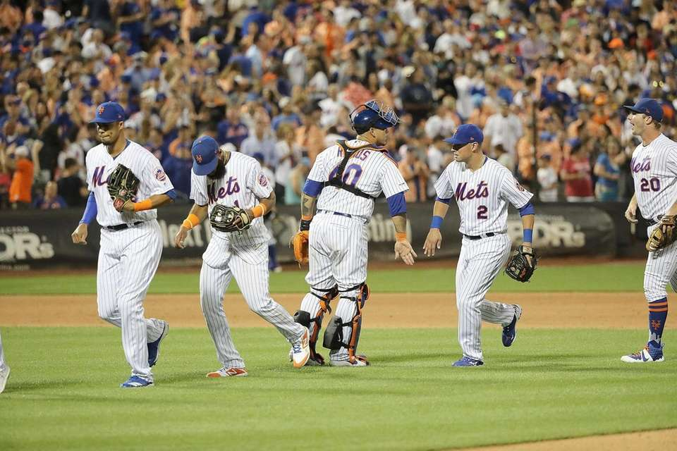 The winning Mets celebrate after the last out