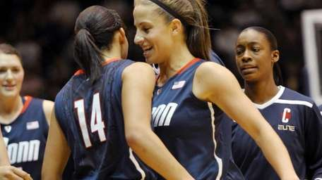 Connecticut's Caroline Doty (5) and Bria Hartley (14)