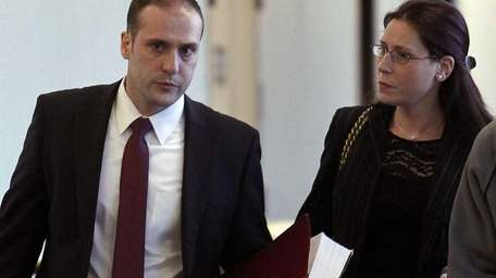 Jennifer Jorgensen consults with her attorney Martin Lorenzotti
