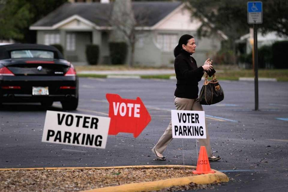 A voter arrives at a polling station on