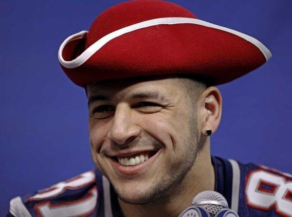 New England Patriots tight end Aaron Hernandez smiles