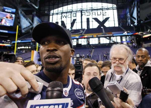 New England Patriots wide receiver Chad Ochocinco answers