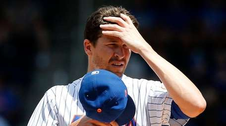 Mets pitcher Jacob deGrom stands on the mound