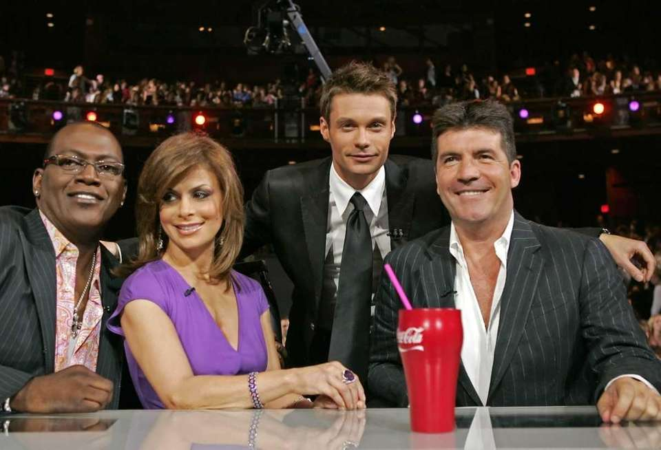 Judges Randy Jackson, left, Paula Abdul, center, host