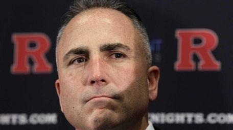 Rutgers football coach Kyle Flood listens to a
