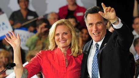 Mitt Romney and wife Ann celebrate during a