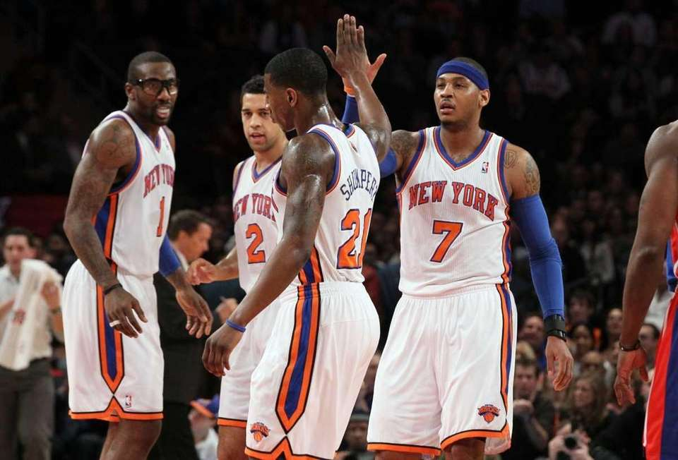 Carmelo Anthony celebrates a play against the Detroit