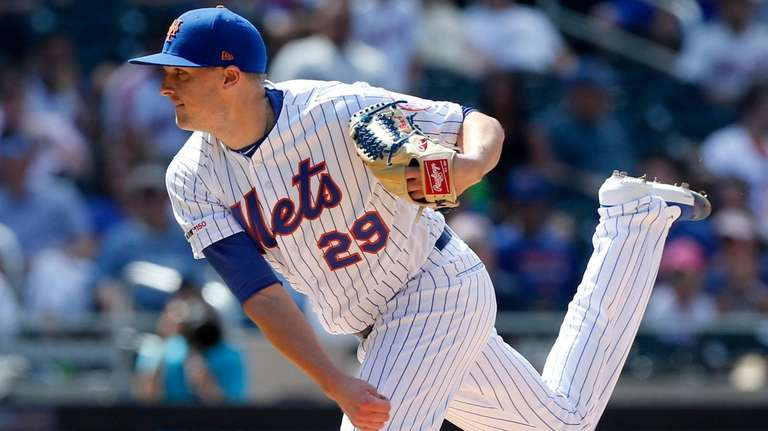 Brad Brach of the Mets pitches against the