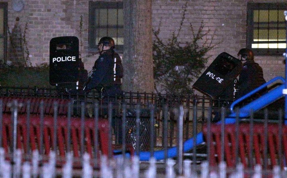 Police outside an apartment complex near 370 Bushwick