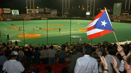 Fans wave a Puerto Rican flag at the