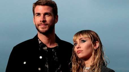 Miley Cyrus and Liam Hemsworth arrive for