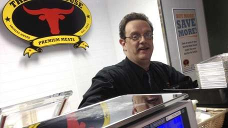John Timmermann presides over the butcher counter at