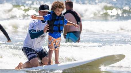Jayce Figueroa, 5, of Brooklyn catches a wave