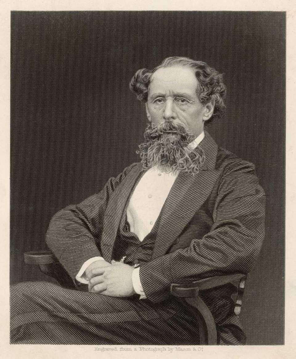 The British author Charles Dickens sits for a