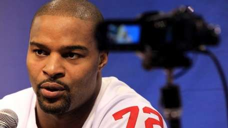 Osi Umenyiora answers questions from the media during