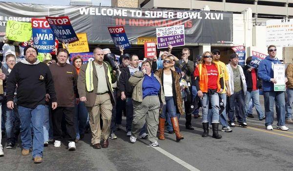 Indiana AFL-CIO president Nancy Gayott, blue shirt center,